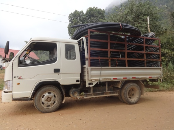 One of 31 truckloads to the village of Katang Xieng so far.  this is water pipe for the village.